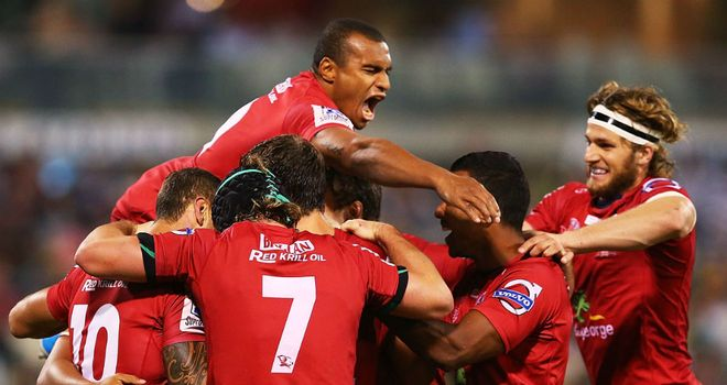 The Reds celebrate after Chris Feauai-Sautia's late try beat the Brumbies