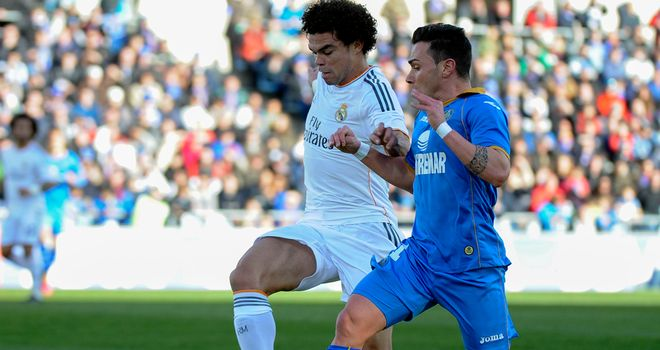 Real Madrid's defender Pepe vies with Getafe's Adrian Colunga