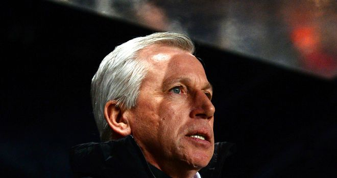 Pardew: was jeered by the away fans at the Emirates Stadium