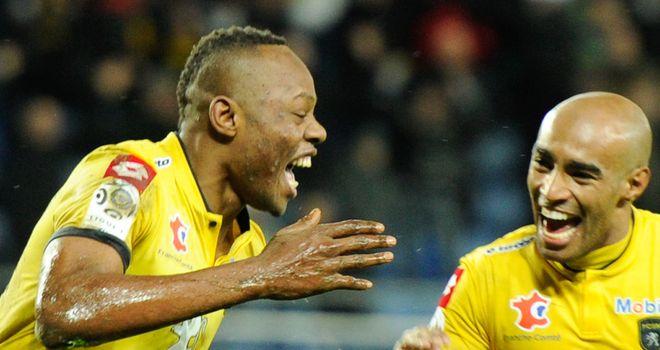 Sochaux's Zambian defender Stoppila Sunzu celebrates