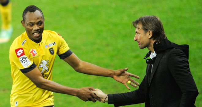 Sochaux's Stoppila Sunzu is congratulated by Herve Renard
