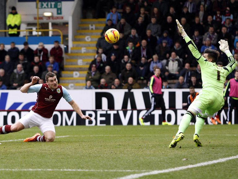 Burnley's Sam Vokes scores during their 3-1 win