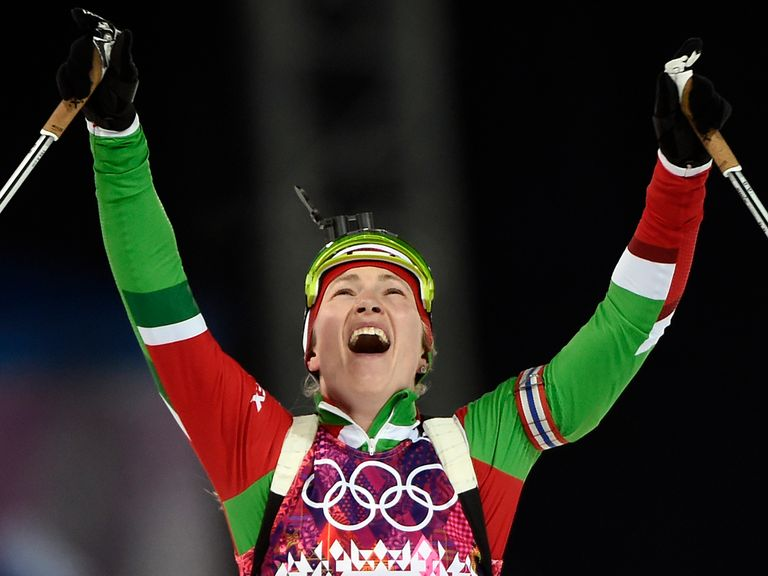 Darya Domracheva celebrates after clinching her third gold medal