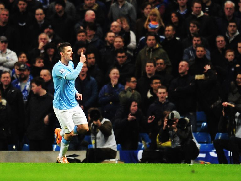 Stevan Jovetic celebrates after opening the scoring at the Etihad