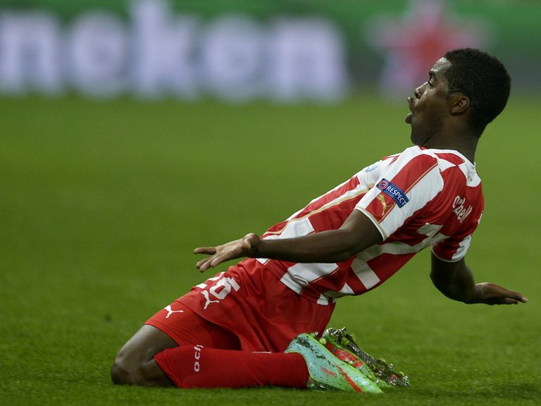Joel Campbell: Olympiakos' on-loan Arsenal man celebrates his strike against Manchester United