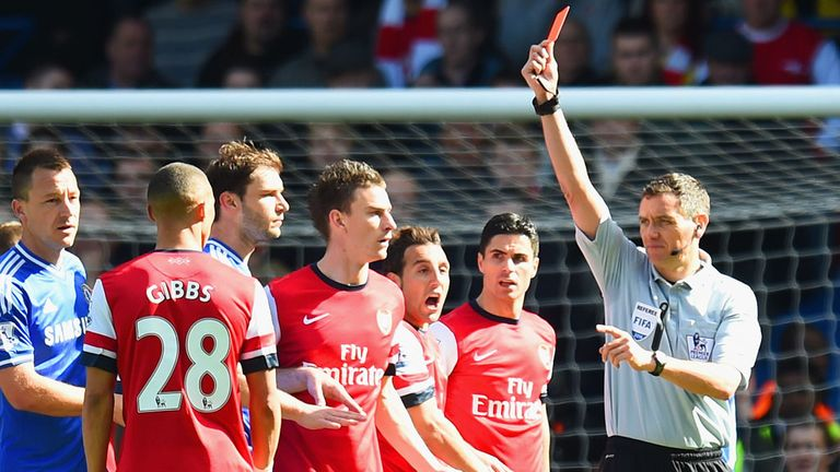 Andre Marriner sends off Kieran Gibbs instead of Alex Oxlade-Chamberlain at Stamford Bridge.