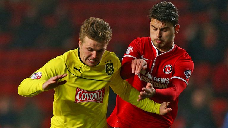 Charlton's Astrit Ajdarevic and Danny Ward of Huddersfield in action
