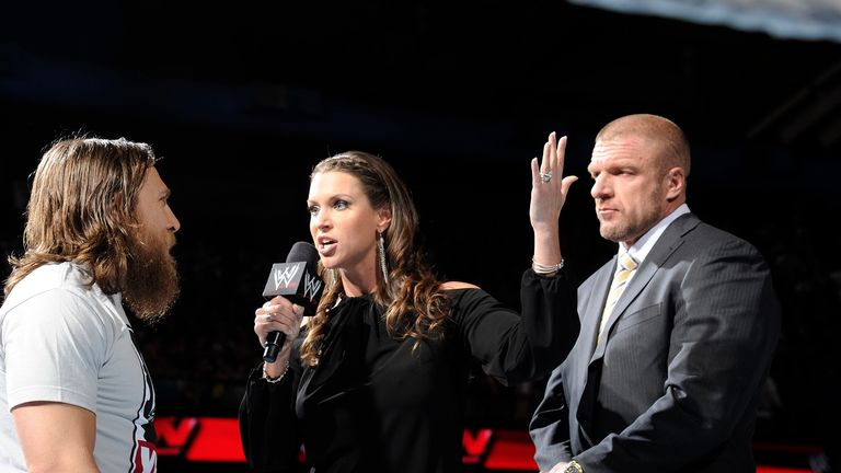 Daniel Bryan (L) forced Triple H to accept his WrestleMania challenge on Raw