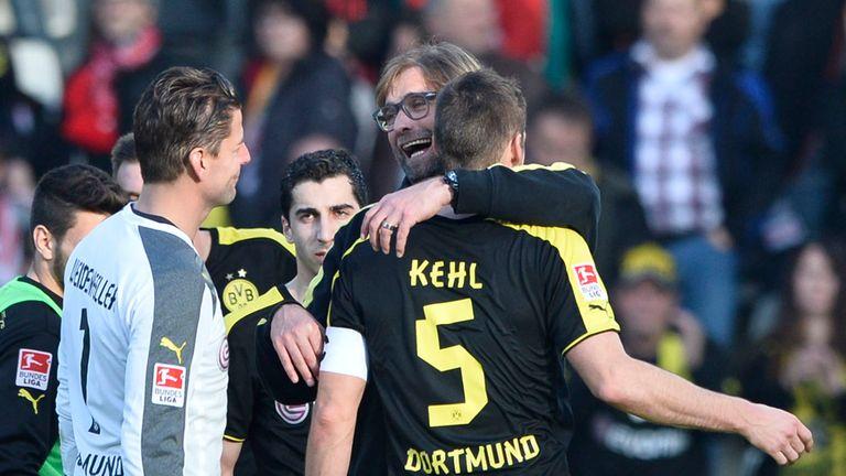 Dortmund boss Jurgen Klopp hugs Sebastian Kehl