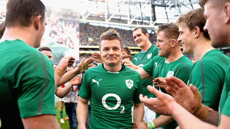 Ireland players congratulate Brian O'Driscoll on Saturday in Dublin