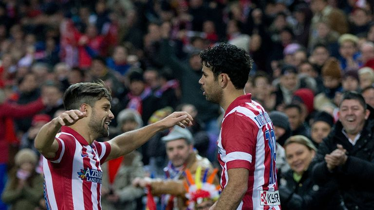 Diego Costa of Atletico de Madrid celebrates scoring their second goal with Diego Ribas