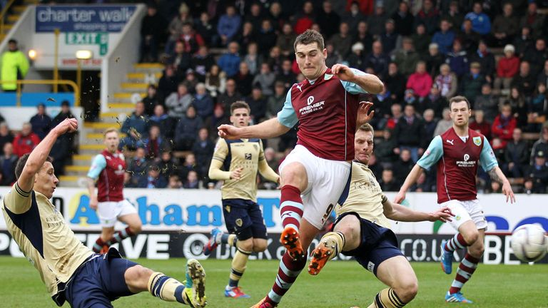 Jason Pearce (l): Leeds defender scores an own goal at Burnley