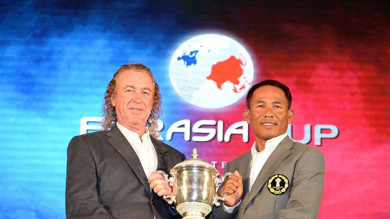 Miguel Angel Jimenez and Thongchai Jaidee with the EurAsia Cup trophy