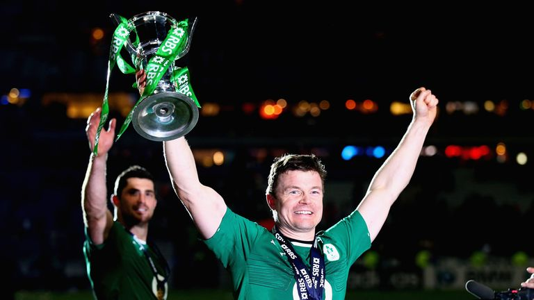 Brian O'Driscoll celebrates with the Six Nations trophy