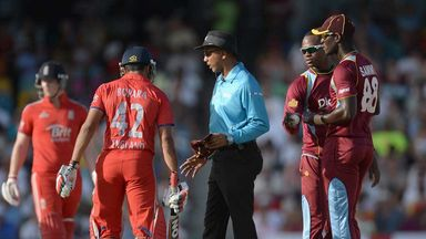 Bopara is spoken to following his confrontation with Sammy and Samuels (right)