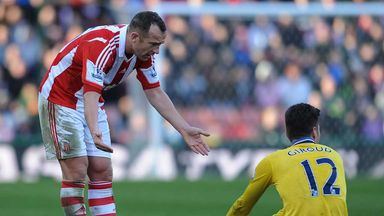 Charlie Adam tangles with Arsenal striker Olivier Giroud
