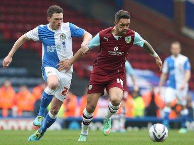 Danny Ings of Burnley holds off Corry Evans of Blackburn Rovers