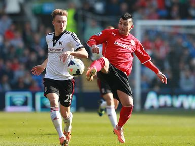 Fulham's Cauley Woodrow left and Cardiff's Gary Medel