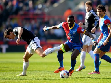 Yannick Bolasie of Crystal Palace takes on Jack Cork