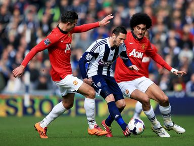 West Brom's Morgan Amalfitano takes on Robin van Persie and Marouane Fellaini