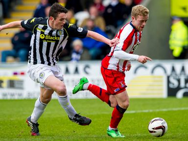 John McGinn challenges for the ball with Rory McKenzie