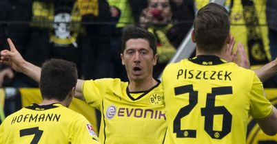 Dortmund celebrate on their way to victory at Hannover