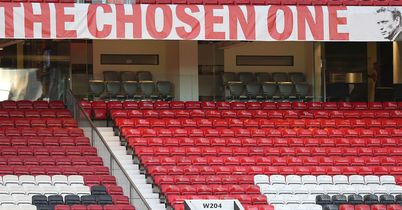 The Chosen One banner still hangs high ahead of Man United's crunch Champions League clash with Olympiacos despite the debate surrounding David Moyes