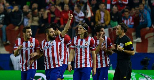 Arda Turan: Celebrating Atletico Madrid's second of the night