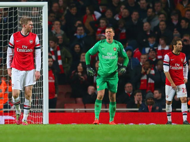 Arsenal players look dejected after the late own-goal at the Emirates Stadium