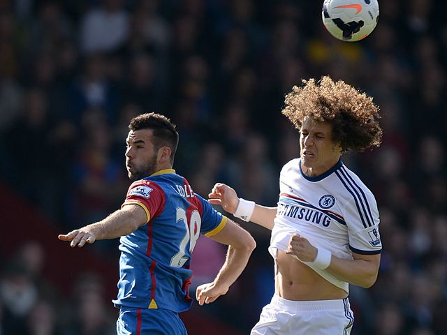 Joe Ledley and David Luiz compete for the ball
