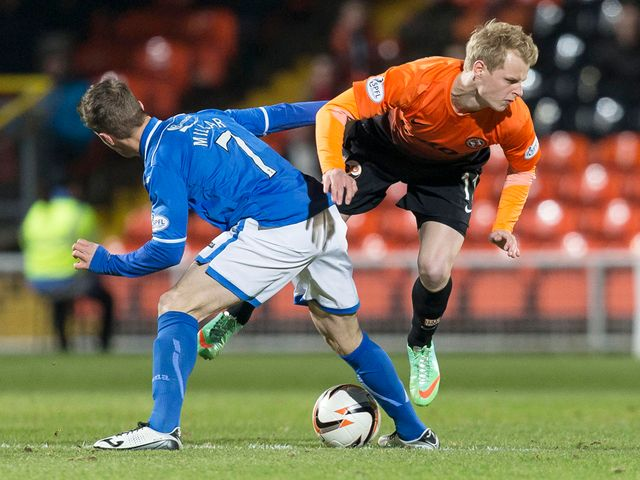 Gary Mackay-Steven is fouled by Chris Millar