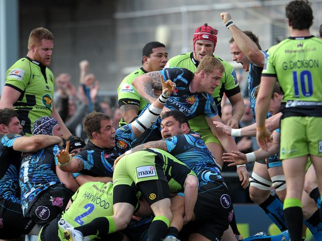 Exeter celebrate as they cross for a try against Northampton
