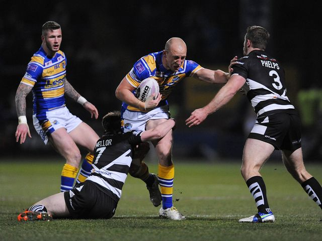 Carl Ablett is tackled by Joe Mellor and Cameron Phelps