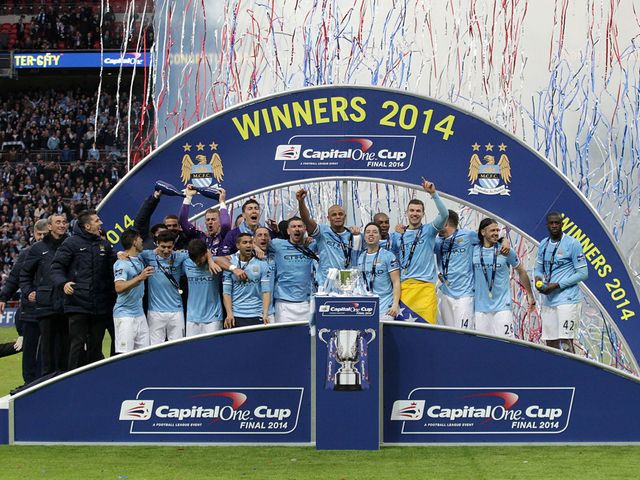 Manchester City celebrate winning the Capital One Cup