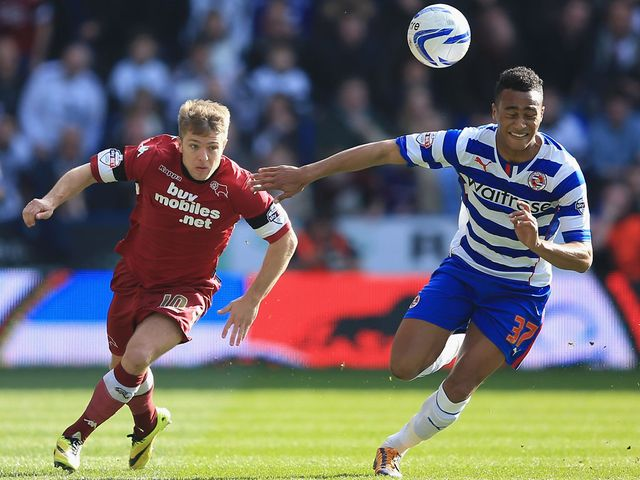 Jamie Ward and Jordan Obita battle for the ball