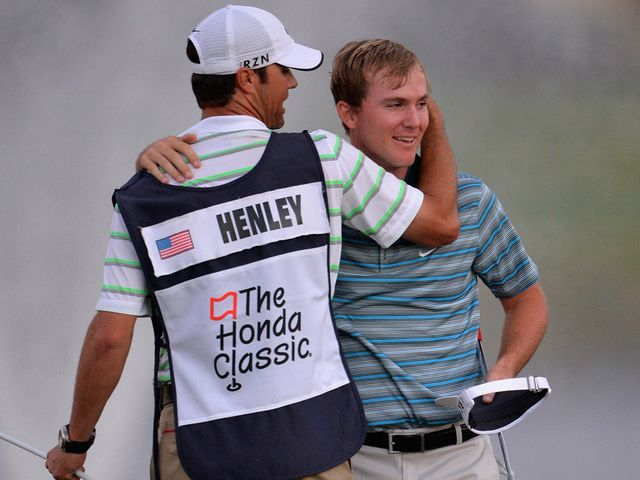 Russell Henley celebrates winning the Honda Classic