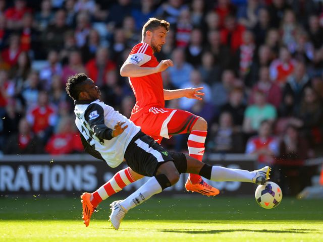 Morgan Schneiderlin is tackled by Daniel Sanchez Ayala