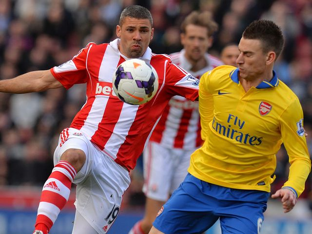 Jon Walters and Laurent Koscielny compete for the ball