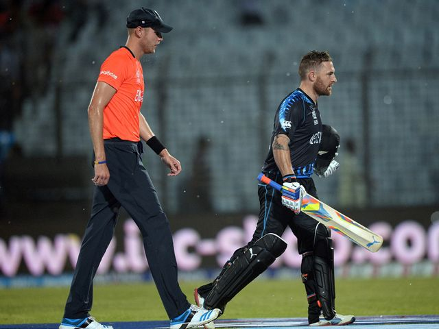 Job done: McCullum (r) heads off as the rain falls in Chittagong