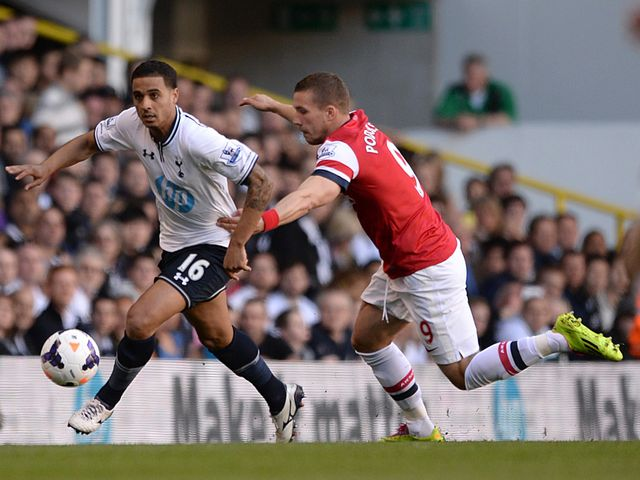 Lukas Podolski gets hold of Kyle Naughton