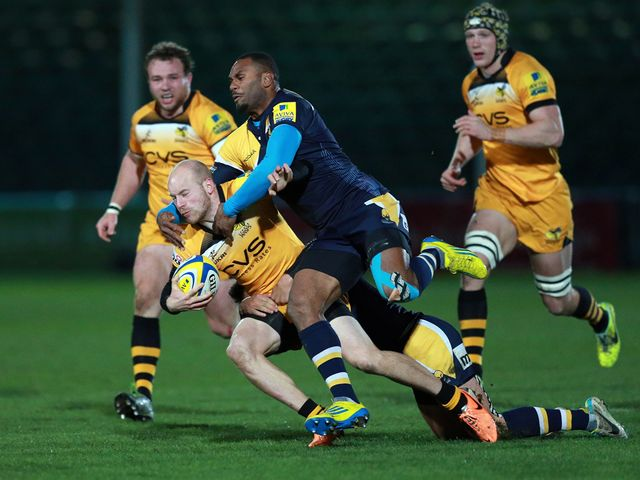 Joe Simpson is tackled by Josh Drauniniu