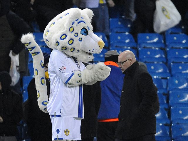 Brian McDermott leaves the field after defeat