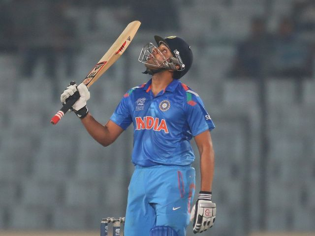 Rohit Sharma celebrates his half century