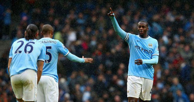 Yaya Toure: Celebrates his hat-trick as Manchester City destroy Fulham 5-0