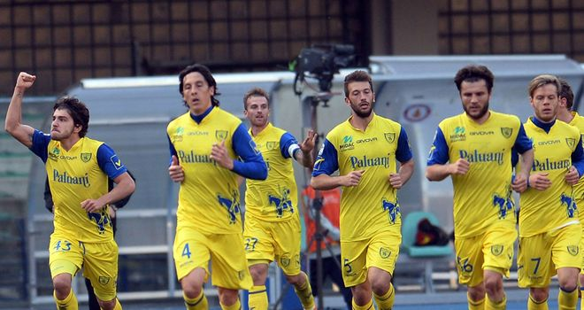 Alberto Paloschi (left) of Chievo celebrates after scoring
