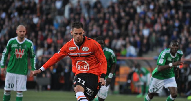 Lorient's Kevin Monnet Paquet shoots and scores