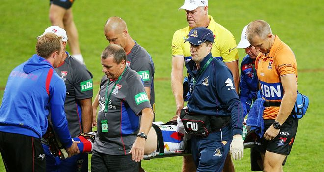 Alex McKinnon is stretchered off after breaking his neck
