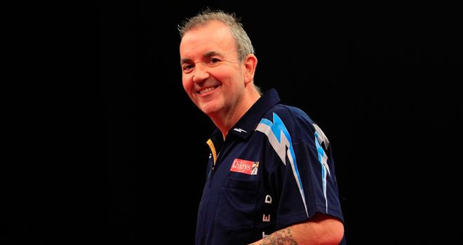 Phil Taylor: Began defence of England's title with easy win alongside Adrian Lewis