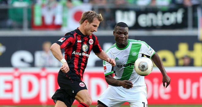 Stefan Aigner and Junior Malanda battle for the ball