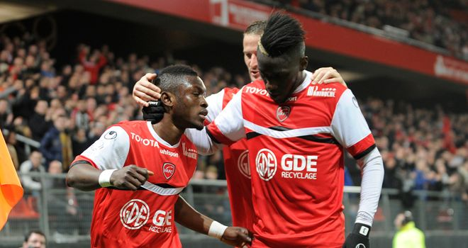 Valenciennes' Ghanean forward Majeed Waris is congratulated